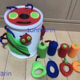 ミルク缶で作る、0歳から遊べる手作りおもちゃ~あおむしのポットン落としとひもとおし~